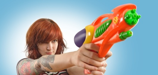 Pretty girl with squirt gun