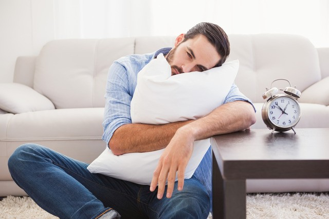 Man hugging pillow